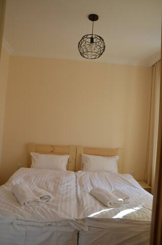 """Double bed in the """"Spring"""" room"""