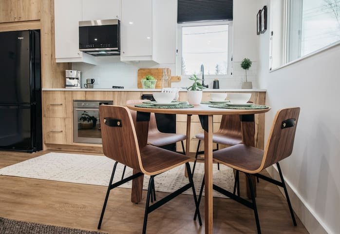 The solid wood table and matching chairs are perfect for having a coffee or eating your own home cooked meal or take out!