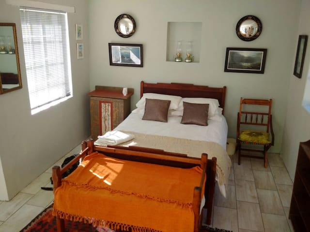 The bedroom side upgraded with an antique cot. Handmade by my grandmother's grandfather