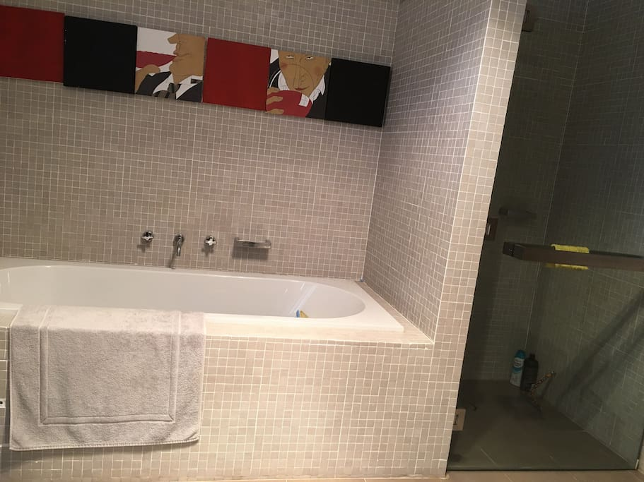 Large open bathroom with bath and shower