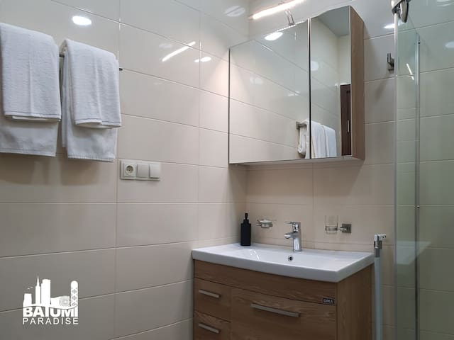 Bathroom with complimentary toiletries and towels.