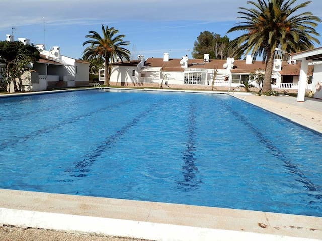 CASA SALVAGINA PETIT 23,Ideal house for your holidays near the sea, free wifi, air conditioning,community pool, pets allowed, dog's beach.