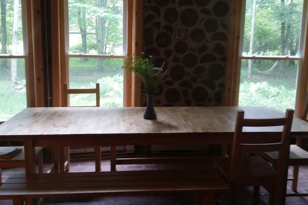 large family dining area surrounded by windows