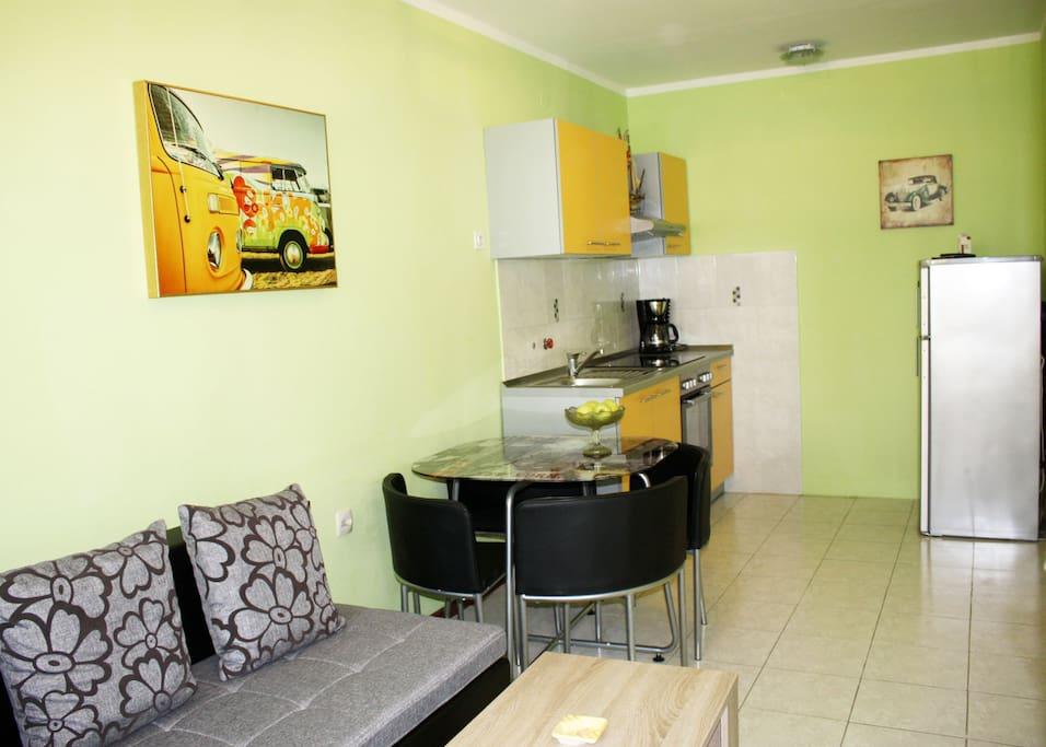 Kitchen and dinning table, fridge, coffee machine