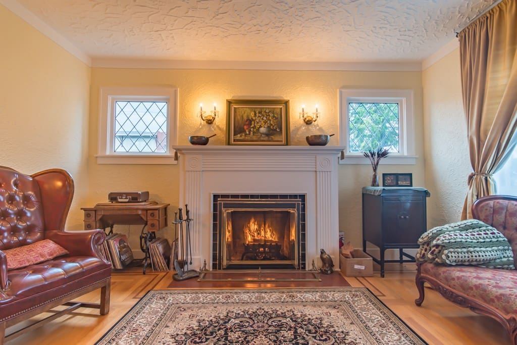 Olympic Homestay: Fireplace, record player, games, books, and HEOS stereo system.