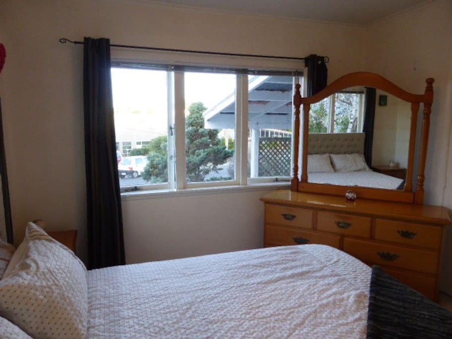 Bedroom photo, light and sunny. Comfortable queen bed, plenty of bedding, lots of room in the wardrobe to hang your clothes and fill the draws.