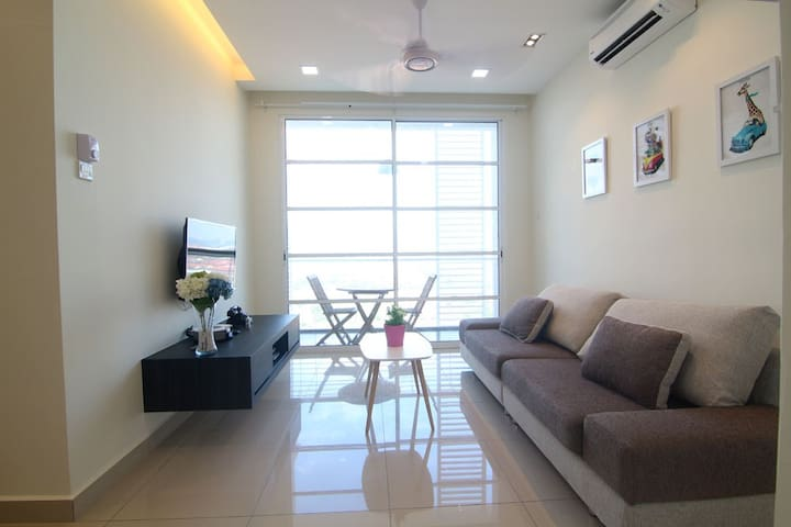 """Living area. 40"""" LED TV, Blu-ray player, 2HP air-con and a comfortable sofa."""
