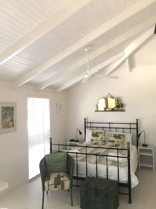 The Porch Room is all white, light and airy with soaring ceilings.