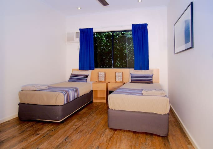 Single beds for kids to sleep in a comfortably air conditioned bedroom