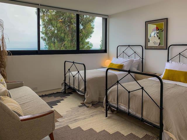 Bedroom #4: 2 twin/single beds, ocean view, closet