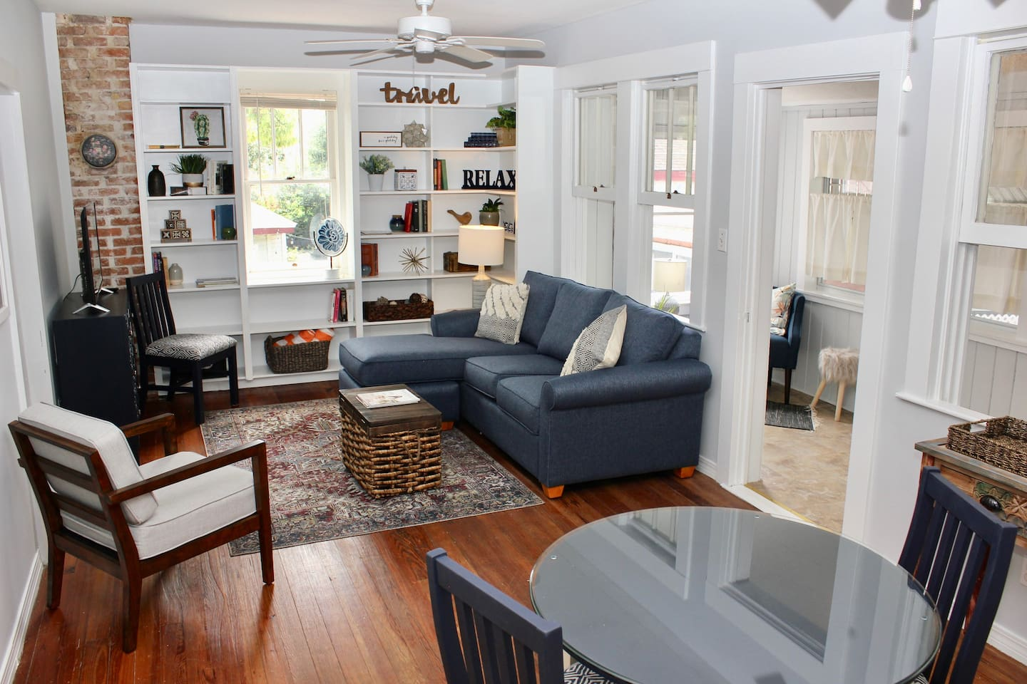 Retreat in the comfortable living room with small dining table for 3, queen-size sofa bed, and flat screen smart TV.