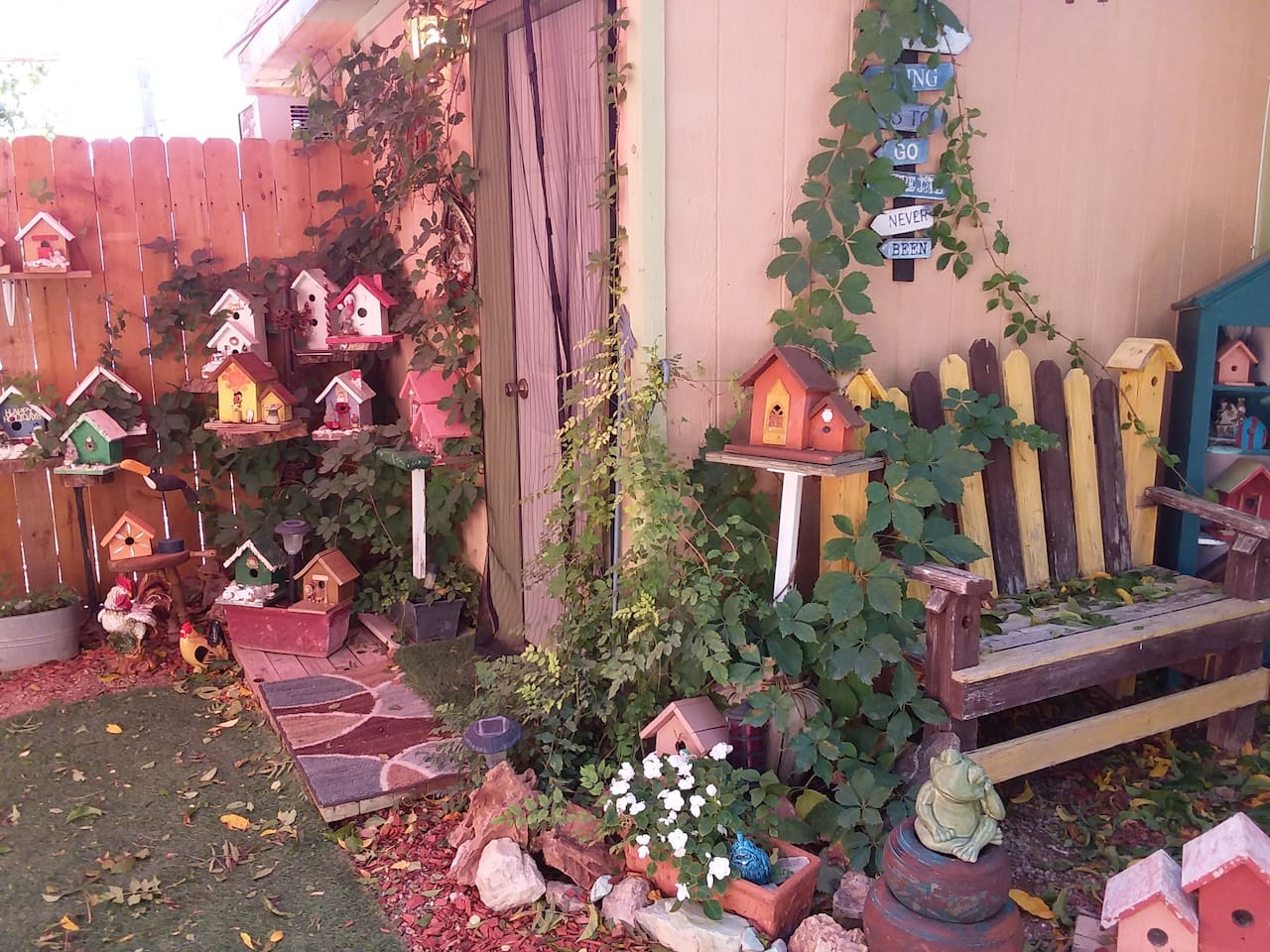 This is the front entrance to the Kookoo'z nest surrounded by many of my favorite handcrafted birdhouses!