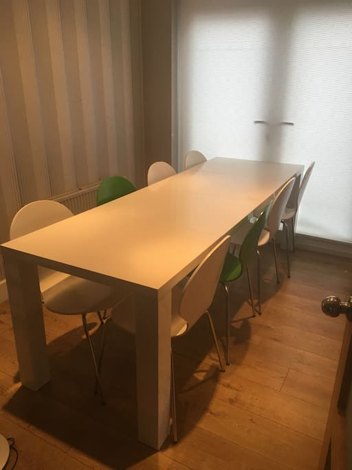 Dining area with extendable table seating 8. (Possible 10 if 1 on each end)