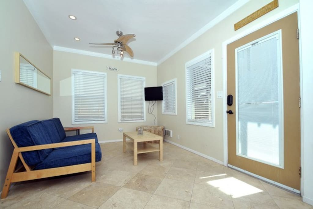 Entry way to the unit and cozy living room with cable TV
