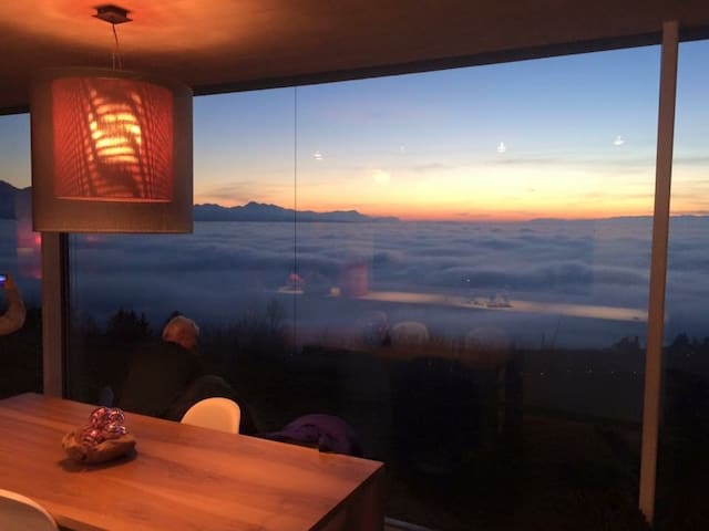 Sunset  from the living room - fog over the lake