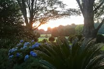 Sunset in the countryside from the patio Adirondack chairs