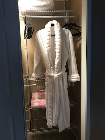 Closet organizer, iron and ironing board, personal fan, extra blanket and 2 fluffy robes!