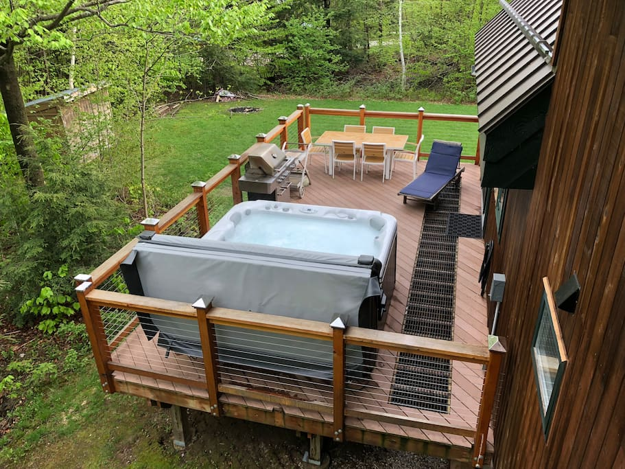 hot tub, outdoor deck, with privacy and seasonal views of the slopes