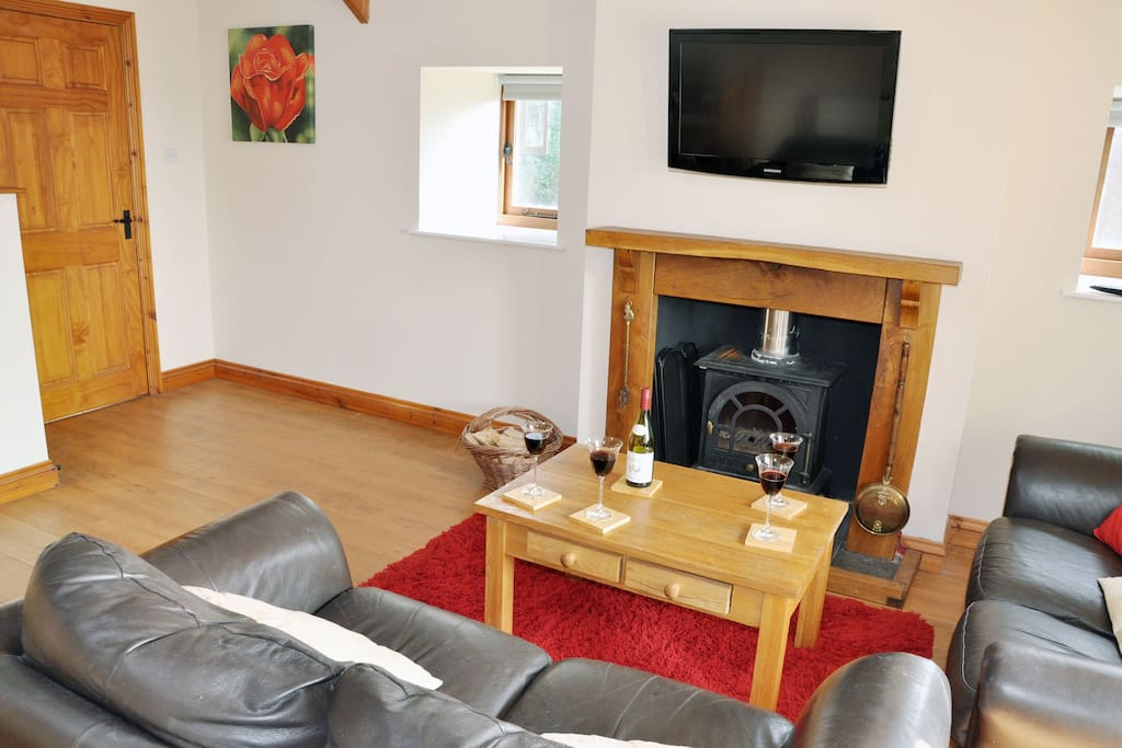 Ground floor sitting room with a wood burning stove