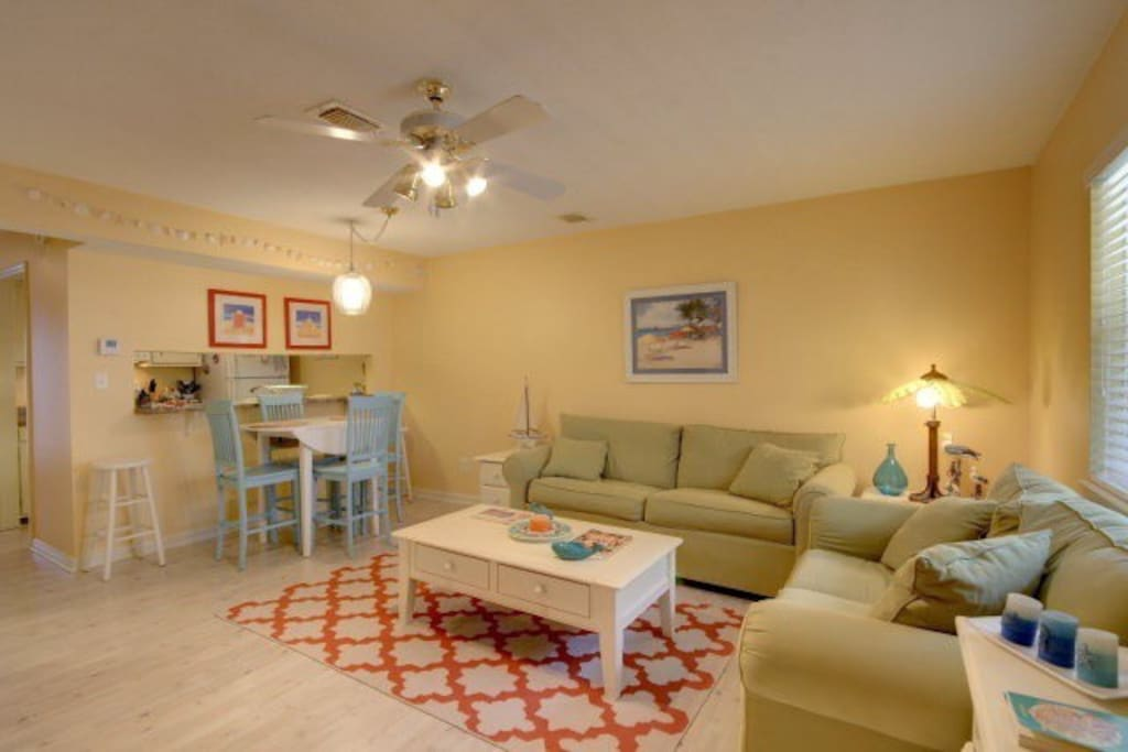 Full size sleeper sofa and love seat. Dining area sits four with two extra stools at the bar.