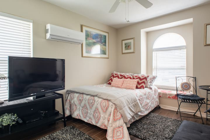 Front guest bedroom with Full/Standard size bed, table & 2 chairs, large TV, quiet room AC/heat and Futon that lets down as a twin bed.