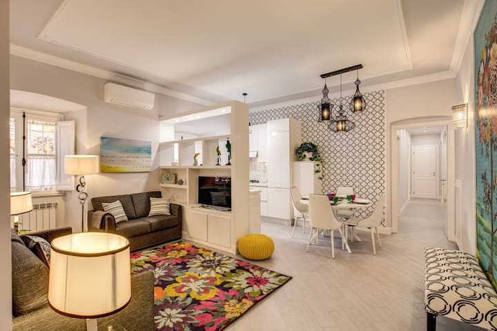 Living room with TV, 1 double sofa bed, 2 seat sofa, air conditioner/ heater and free wifi