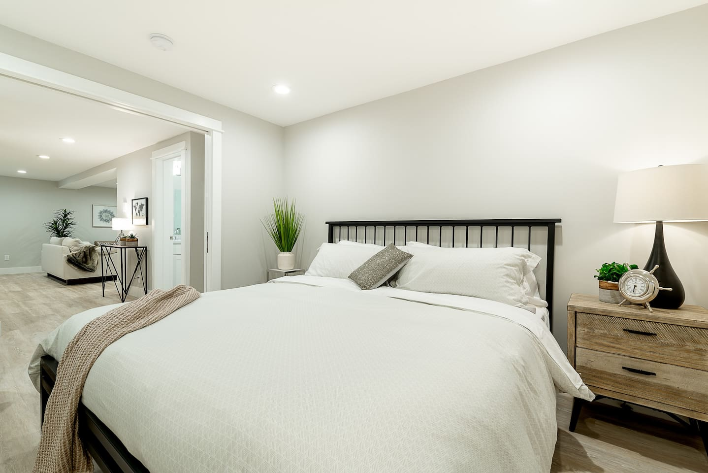 Comfortably sized bedroom with king bed and generous closet space.