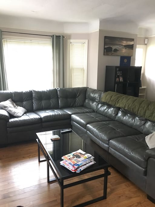 Living room with huge sectional. Easily sleeps 2.