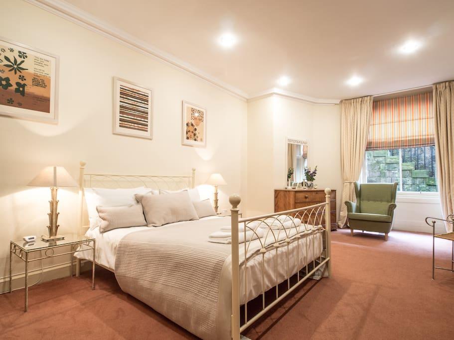 The master bedroom with en-suite bathroom