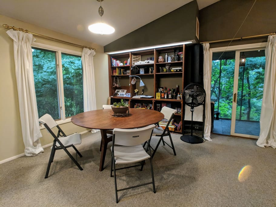 Dining area with games, books, and seats for up to eight. You are welcome to borrow books during your stay.