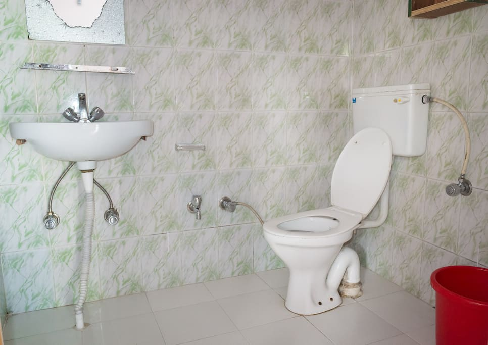 Western style toilet and shower with 24/7 hot water