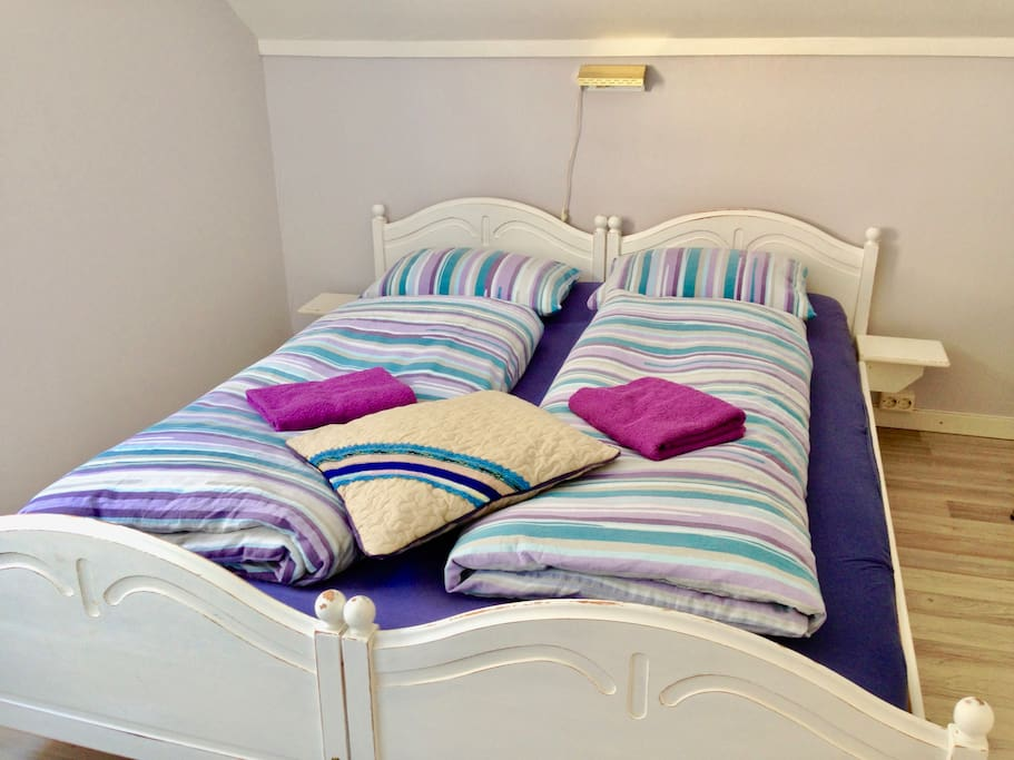 """The room """"STRAND"""". Comfy double bed with new mattresses."""