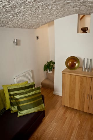 Third bedroom in the converted vaulted cellar with single bed and underfloor heating.