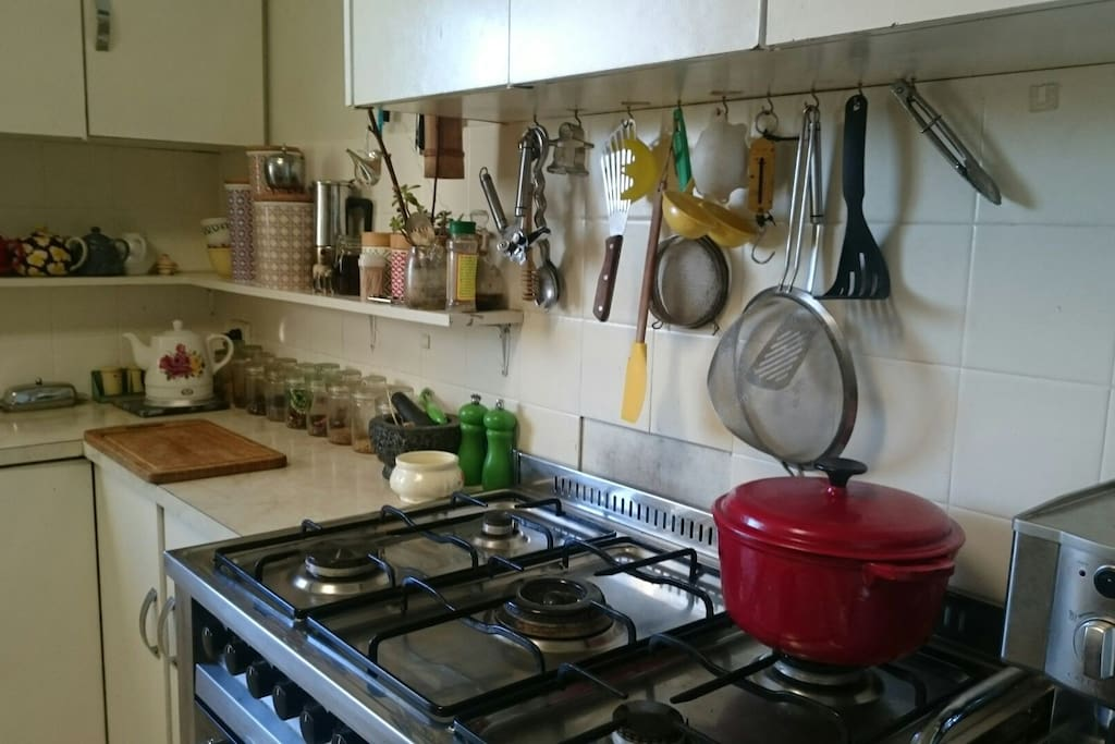 Homely and quirky fully equipped for baking or a tea party in the garden. Five burner stove top and large oven, she begs for a  feast. This kitchen is lived in and loved...