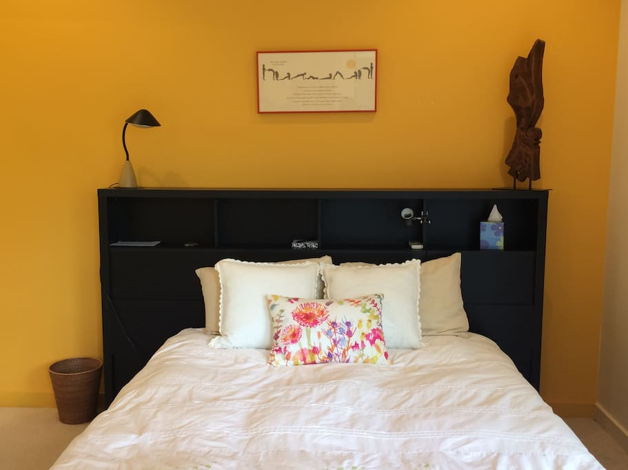 Queen bed with firm new mattress for a restful night