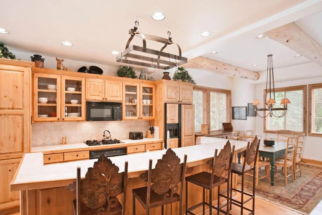 Gourmet kitchen with large dining island with 4 stools