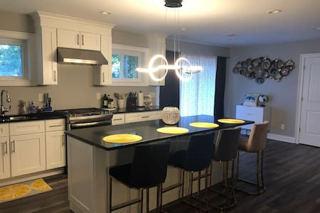 Beautiful newly renovated brick home near airport