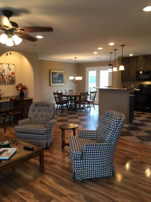 View from the living room to the open kitchen and dining area.