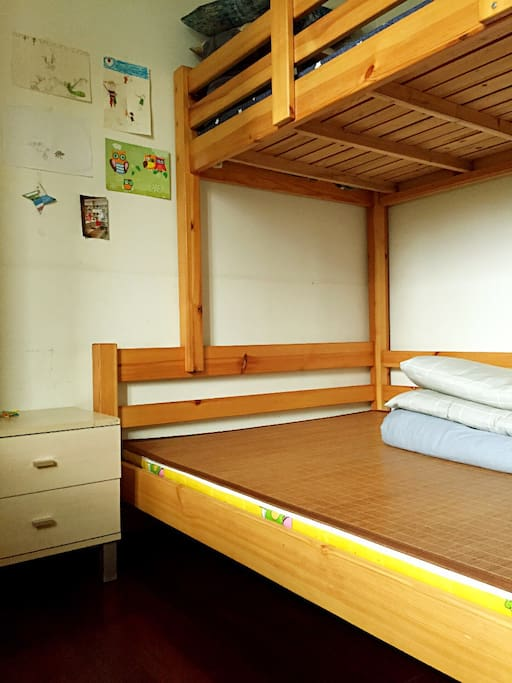 A double-decker bed, 3 people could have a good sleep.