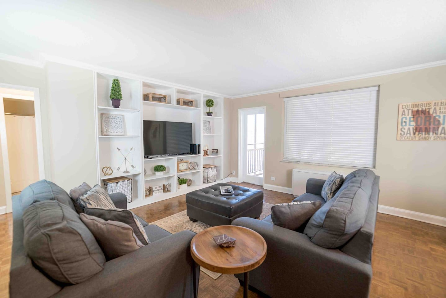 Living Room: Includes a full size couch, a loveseat, and an ottoman.  The full size couch pulls out into a sleeper sofa that includes a Queen size Memory Foam Mattress.