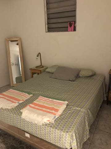 Bedroom 3 with ceiling fan and Queen bed