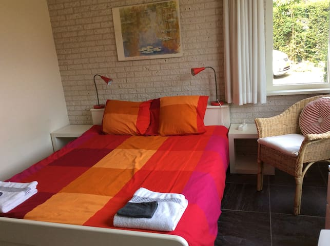 Room with double bed and privet shower.