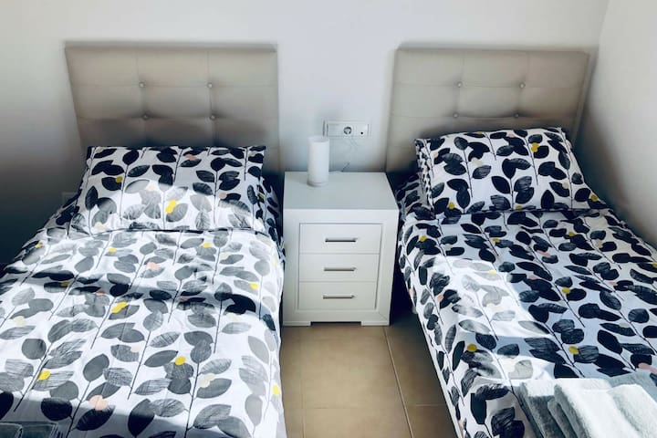 Bedroom 2 - twin beds with ensuite bathroom and spacious wardrobe space