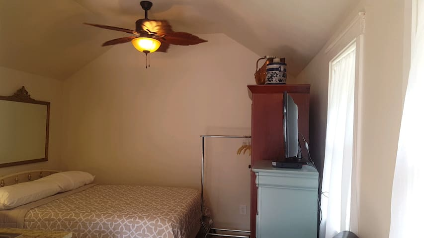 Lofted ceiling with fan.