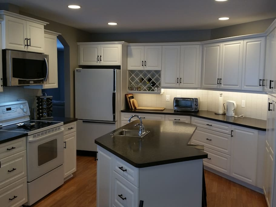 Kitchen with full complement of appliances & utensils