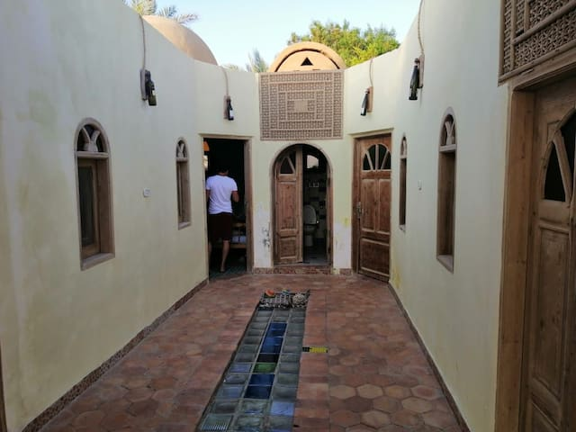 A flat with 4 private rooms on asllah' beach