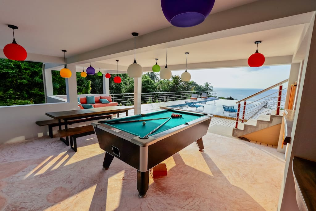 Outdoor Sala with lounge/dining area & pool table