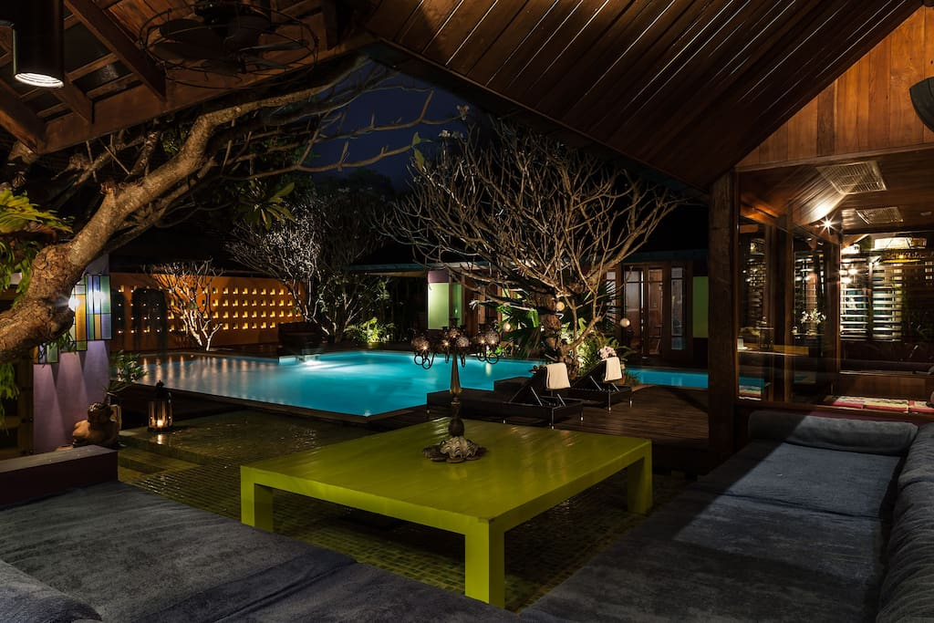Pool lounge area at night time