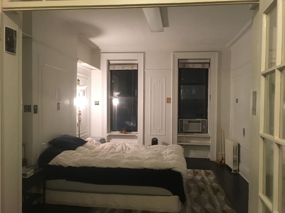 large bedroom with two windows, very bright