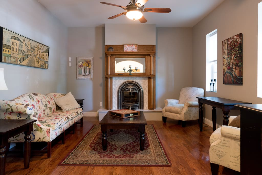 Relax in front of the Victorian style fire place in the spacious, formal living room.